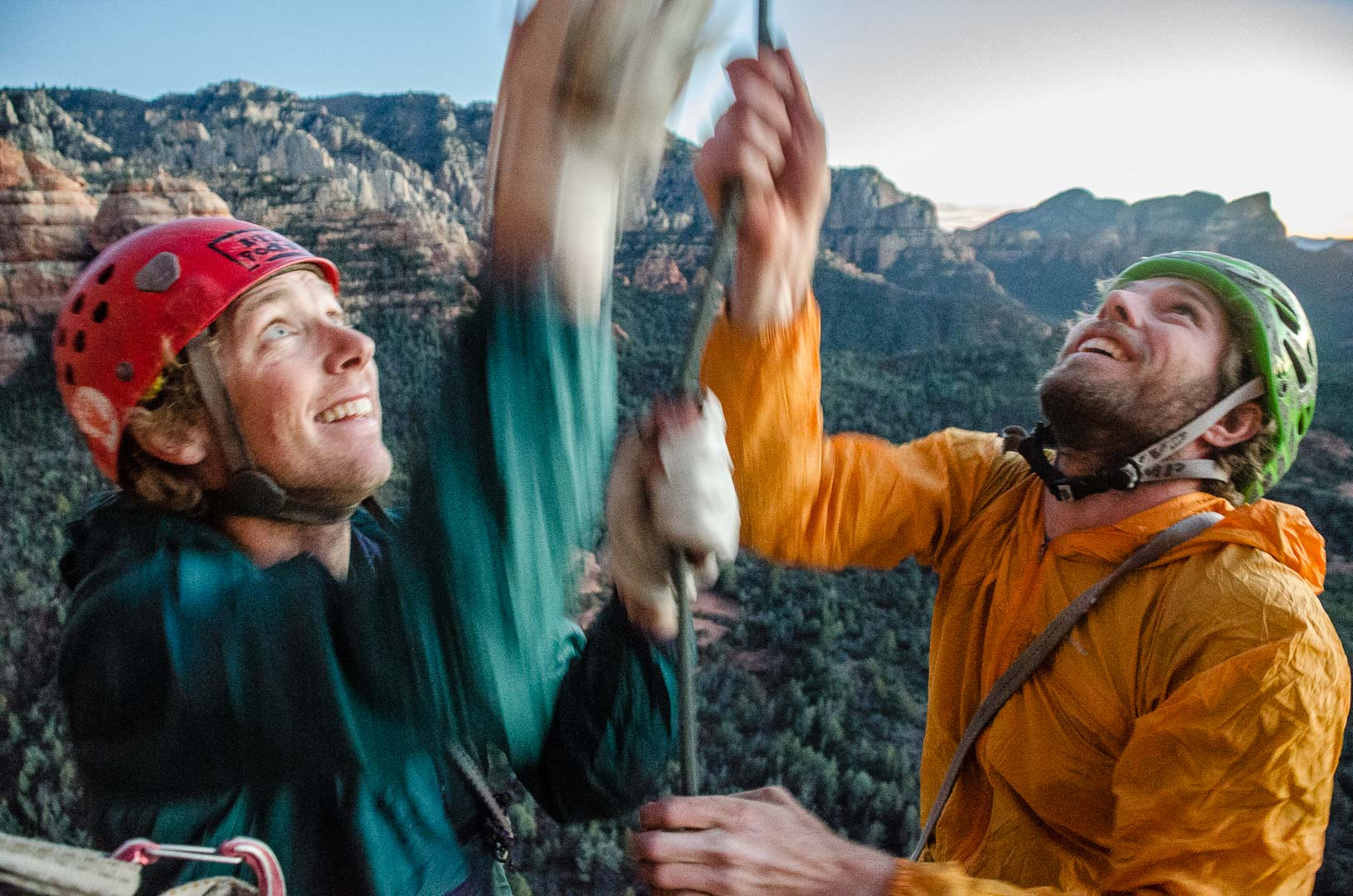 Jeff Snyder and Zach Harrison pull a rope while rappeling off a new route | Sedona, Az